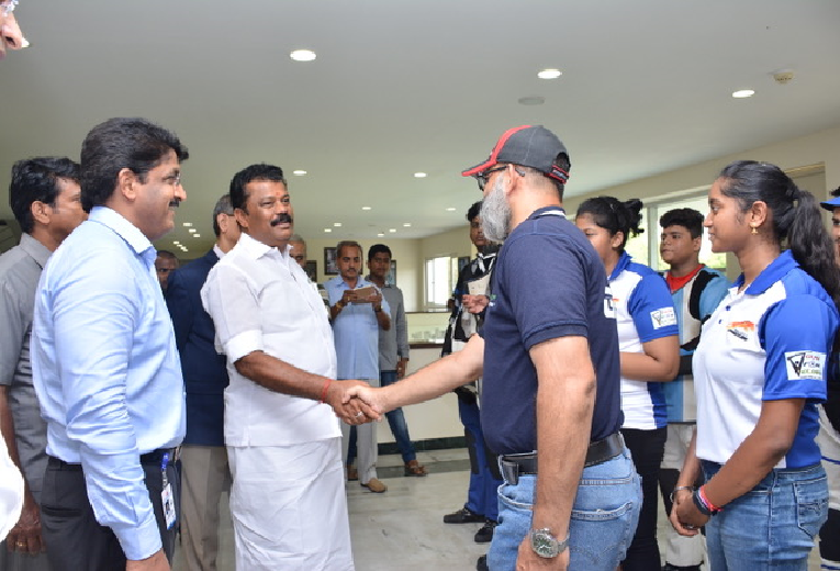 Hon'ble Minister greeting Mr Yousuf from Gun for Glory Shooting Academy