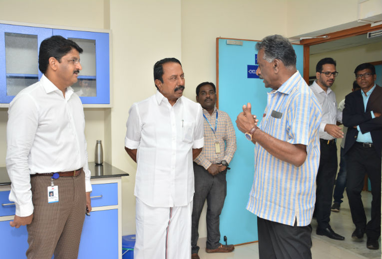 Minister interacting with Mr.V.Baskaran, former Indian Hockey Captain